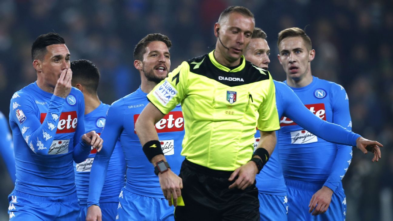 Napoli players argue with the referee after Juventus were awarded a penalty.