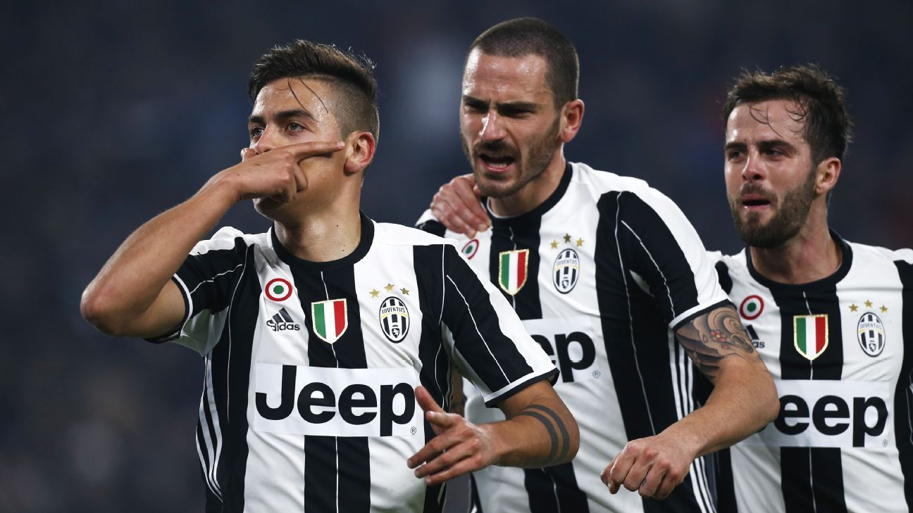 Paulo Dybala celebrates after scoring a penalty against Napoli in the Coppa Italia.