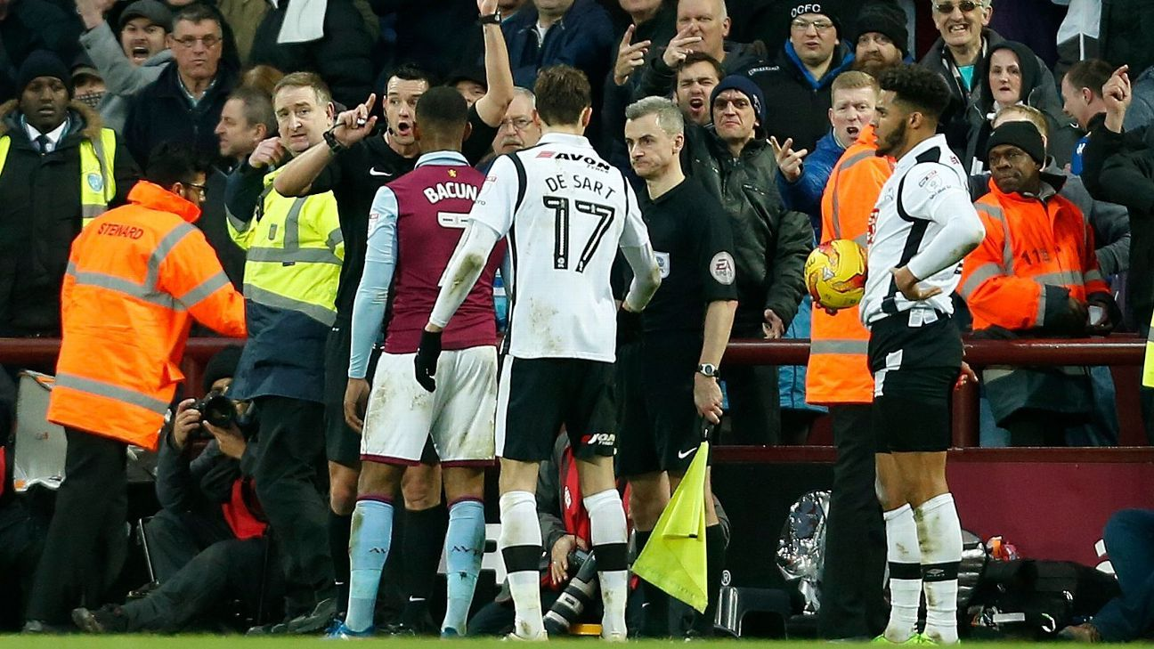 Leandro Bacuna receives his marching orders during Aston Villa's game against Derby County.