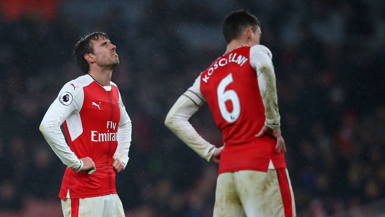 Nacho Monreal and Laurent Koscielny