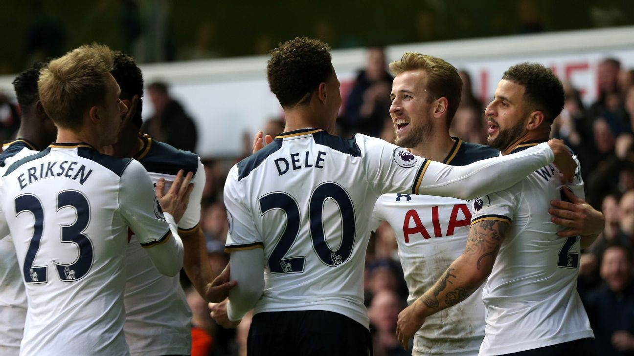 Harry Kane of Tottenham Hotspur celebrates with team mates after he scores his second goal vs. Everton.