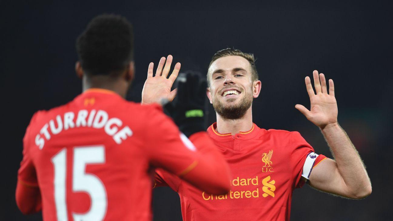 Daniel Sturridge and Jordan Henderson in action for Liverpool.