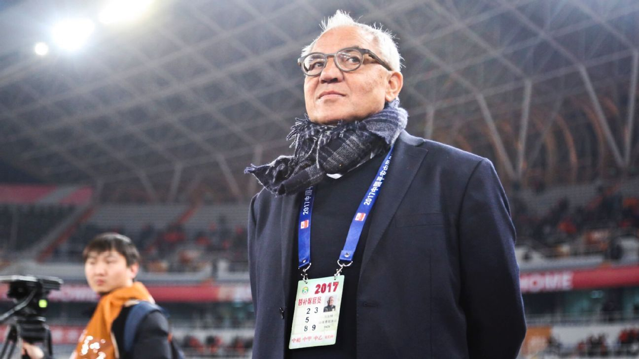 Felix Magath, head coach of Shangdong Luneng, looks on during the game against Guangzhou Evergrande.