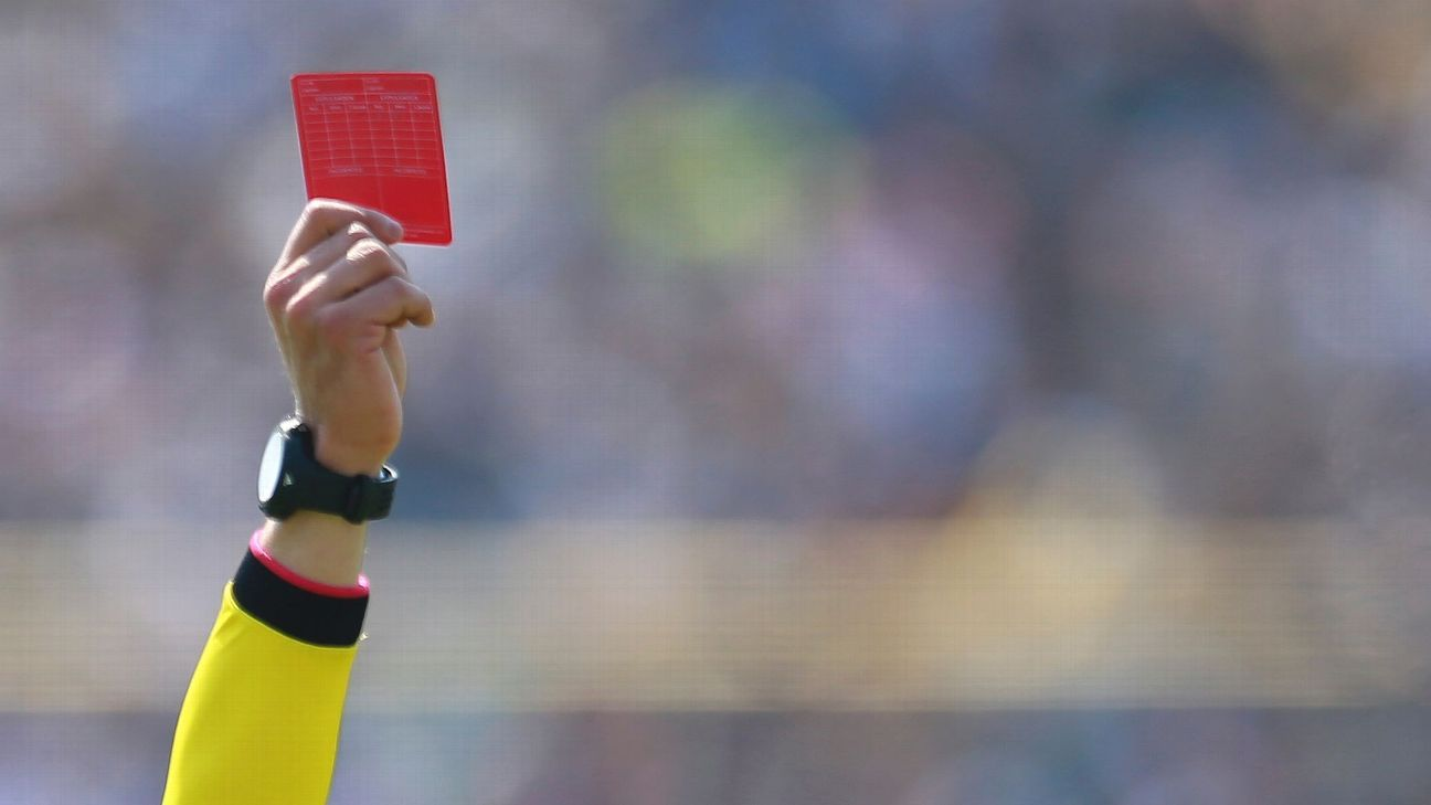 Referee brandishes a red card