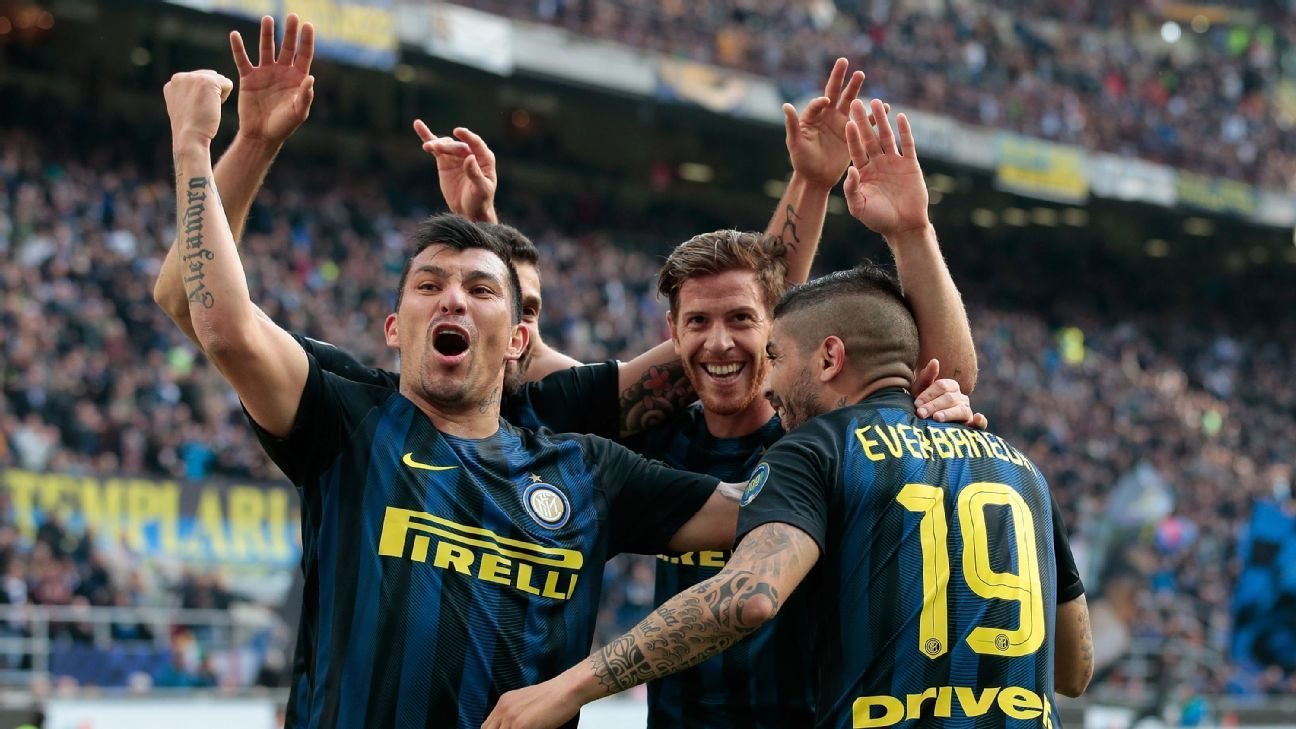 Ever Banega celebrates scoring the first of his goals against Atalanta.