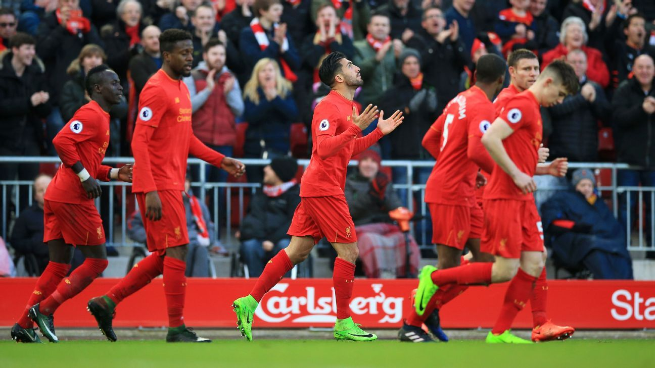 Liverpool celebrate after Emre Can scores their winner.