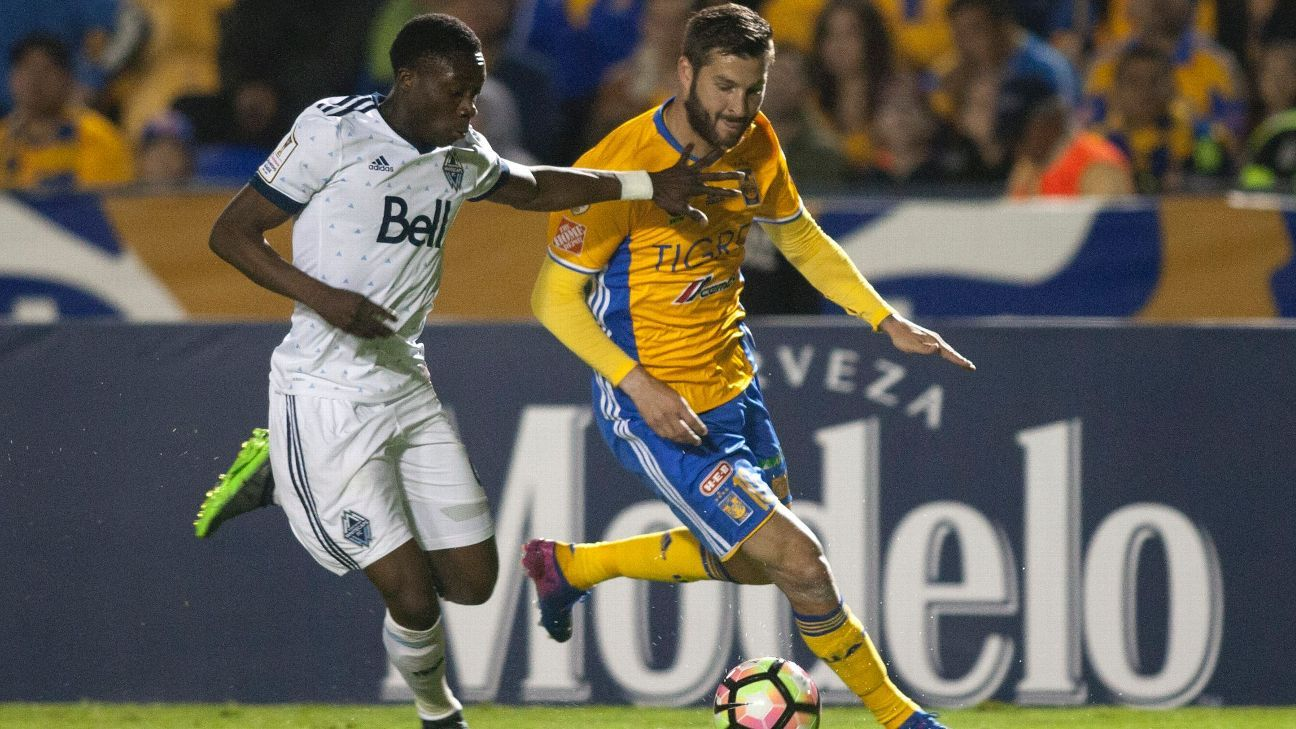 Alphonso Davies, left, and Andre-Pierre Gignac vie for the ball in a CCL match between Vancouver and U.A.N.L.