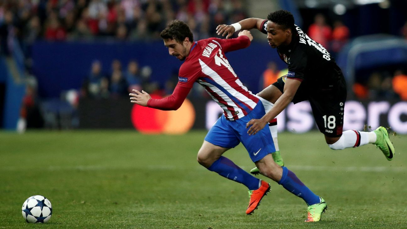 Atleti's Sime Vrsaljko, left, and Wendell of Bayer Leverkusen battle for the ball in a Champions League match on Wednesday.