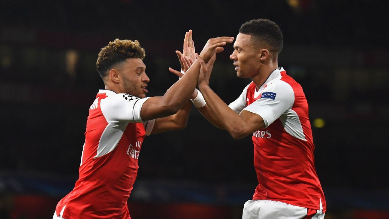 Alex Oxlade-Chamberlain and Kieran Gibbs celebrate a goal during Arsenal's Champions League win against Ludogorets.