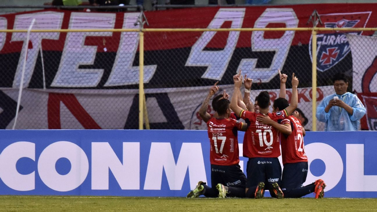 Wilstermann players celebrate goal against Penarol
