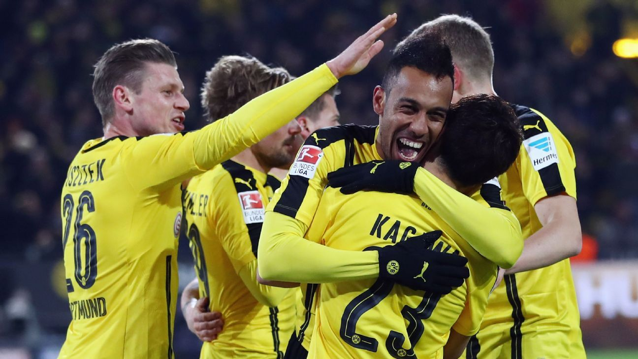 Dortmund players celebrate after Pierre-Emerick Aubameyang's goal.
