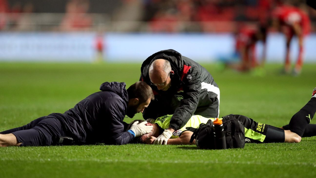 Huddersfield Town's Jonathan Hogg receives treatment on the pitch for an injury suffered against Bristol City.
