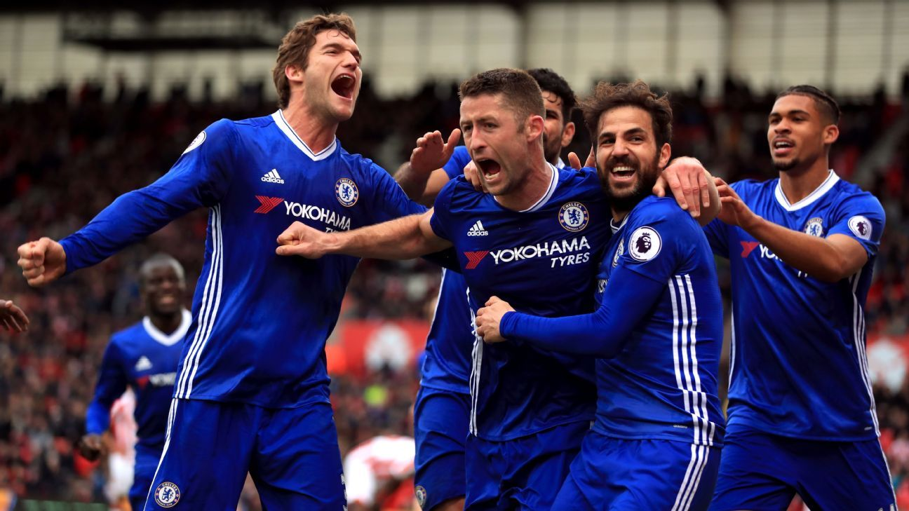 Chelsea players celebrate after a late Gary Cahill winner against Stoke City.