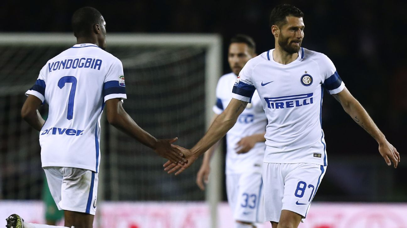 Antonio Candreva celebrates his goal with Geoffrey Kondogbia.