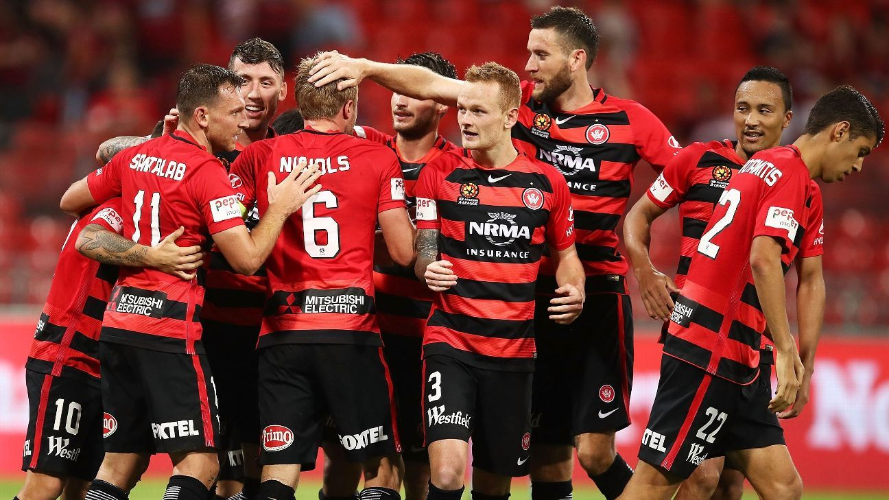 Western Sydney celebrate one of Brendon Santalab's goals.