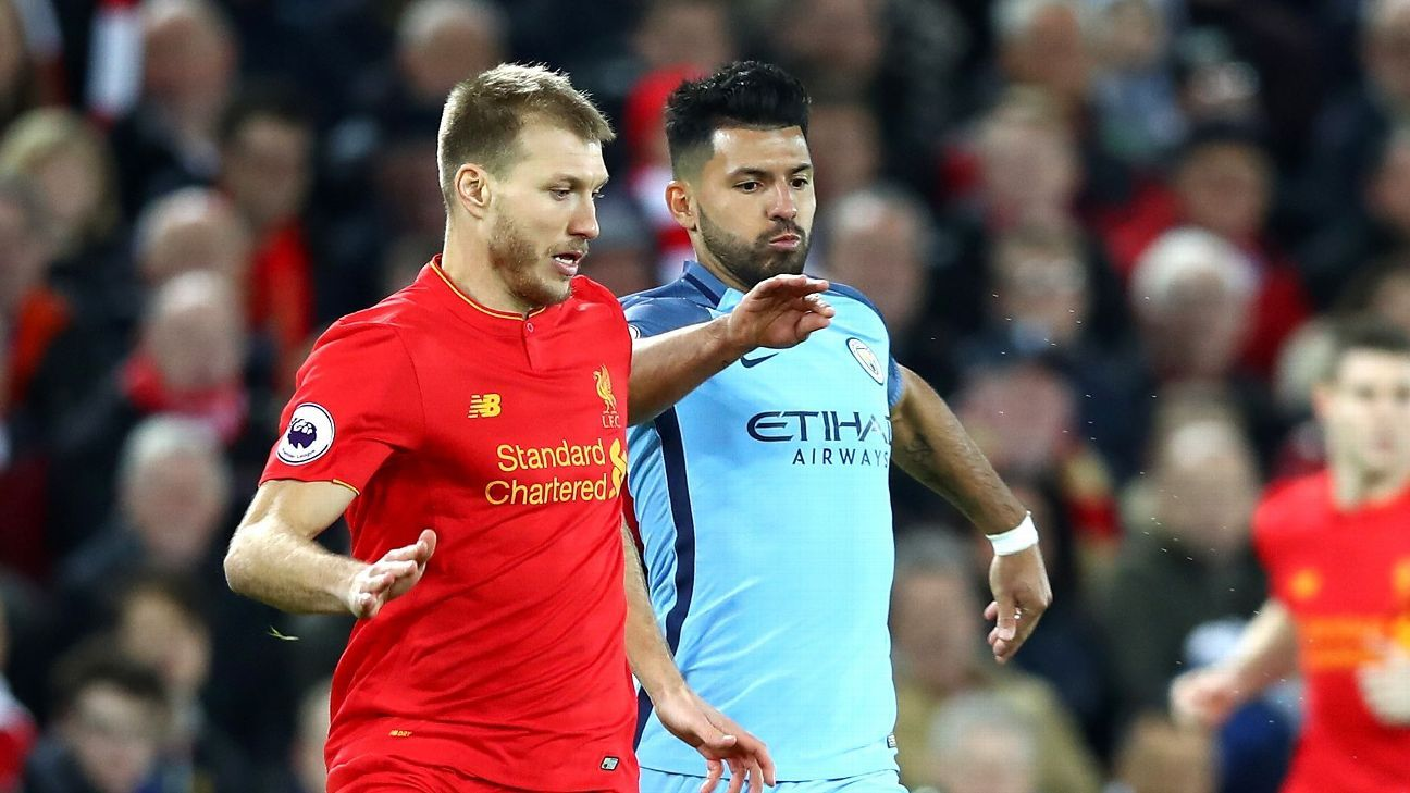 Ragnar Klavan of Liverpool contests possession with Manchester City's Sergio Aguero.