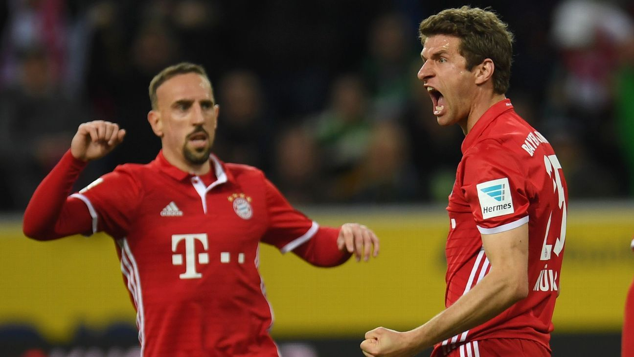 Thomas Muller and Franck Ribery celebrate Bayern's win on Sunday.