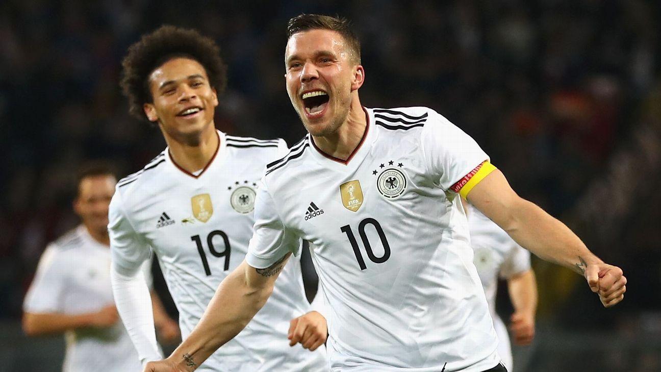 Lukas Podolski celebrates his winning goal against England.