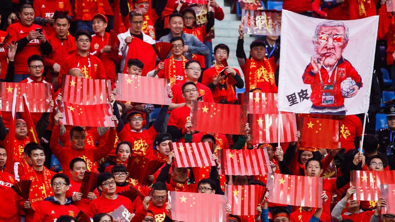 China fans celebrating Yu Dabao's goal against South Korea in the 34th minute.