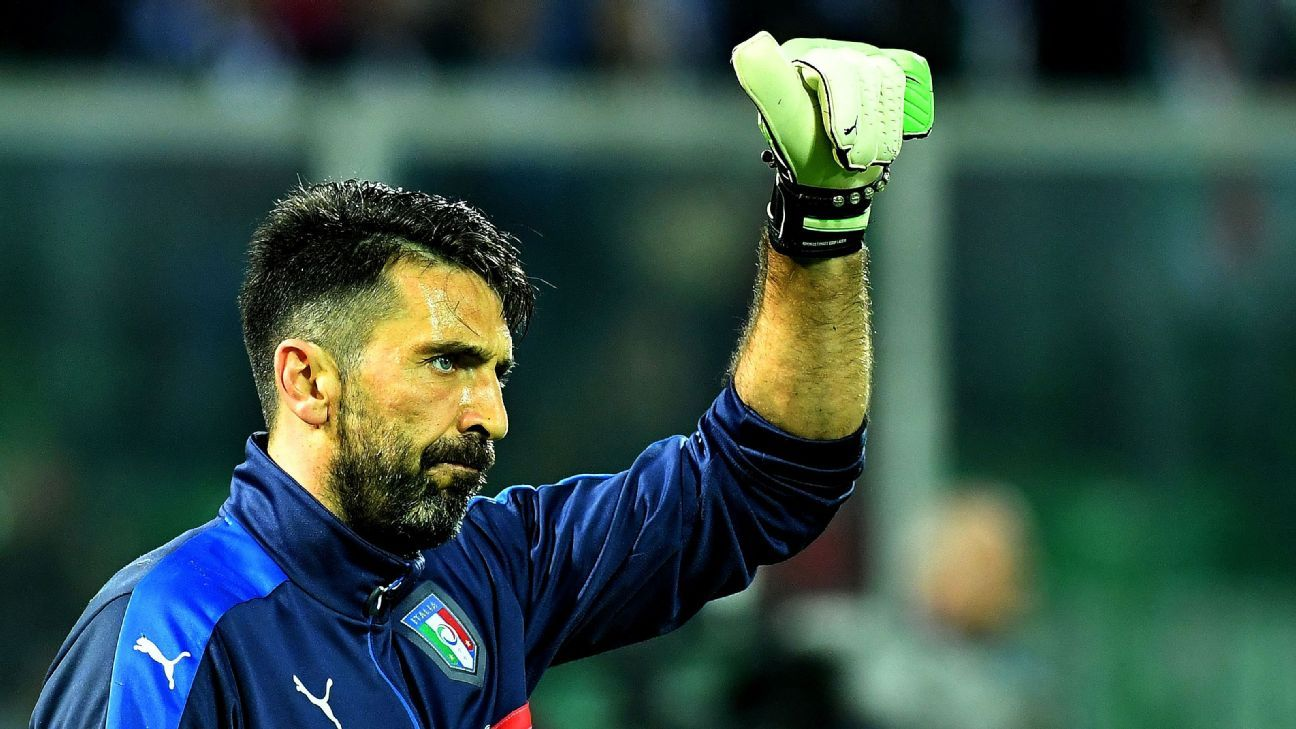 Gianluigi Buffon acknowledges the crowd during his landmark game.
