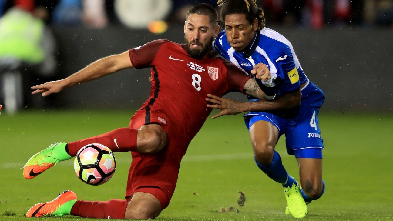 Clint Dempsey goes to ground as he scores a goal against Costa Rica.