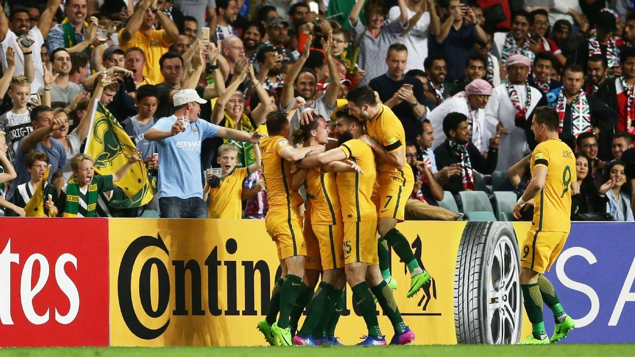 Australia celebrate the opening goal against the United Arab Emirates.