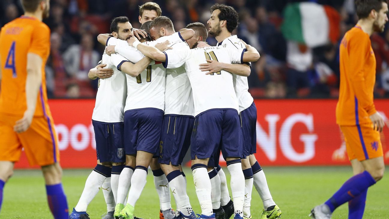 Italy celebrate after scoring against Netherlands on Tuesday.