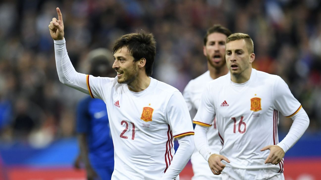 Spain celebrate scoring against France on Tuesday.