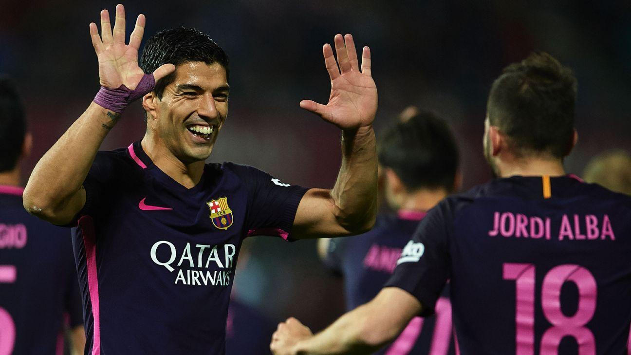 Luis Suarez celebrates his goal against Granada on Sunday.