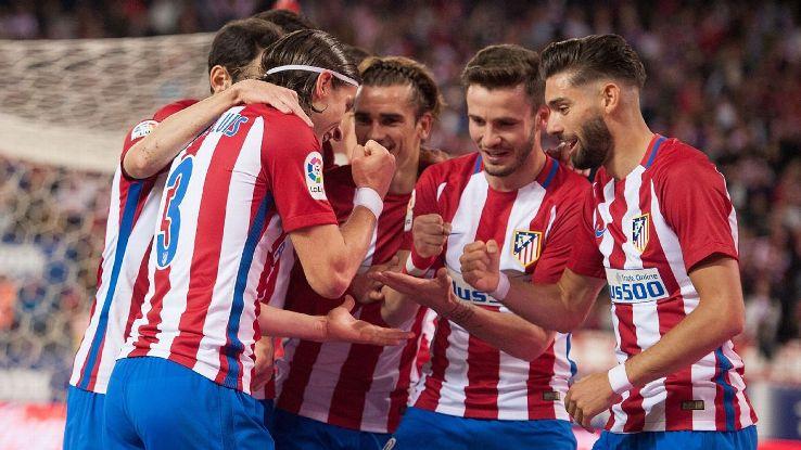 Atletico Madrid celebrate Filipe Luis' first-half goal against Real Sociedad.
