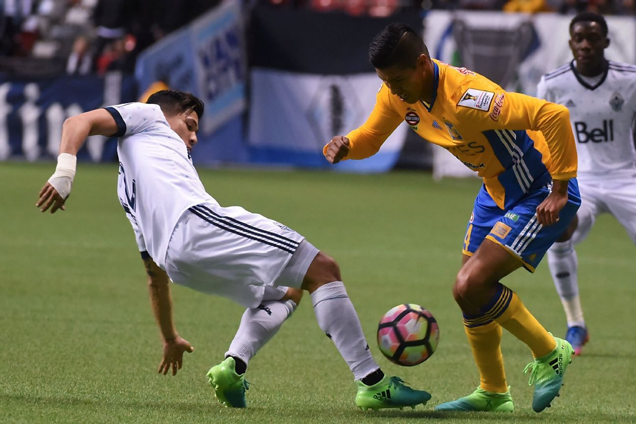 Vancouver Whitecaps' Fredy Montero, left, reaches for the ball against Hugo Ayala of Tigres.