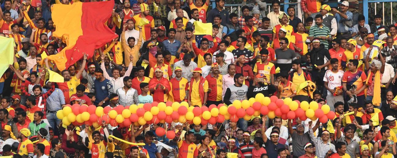 East Bengal supporters root for their team during a match against rivals Mohun Bagan.