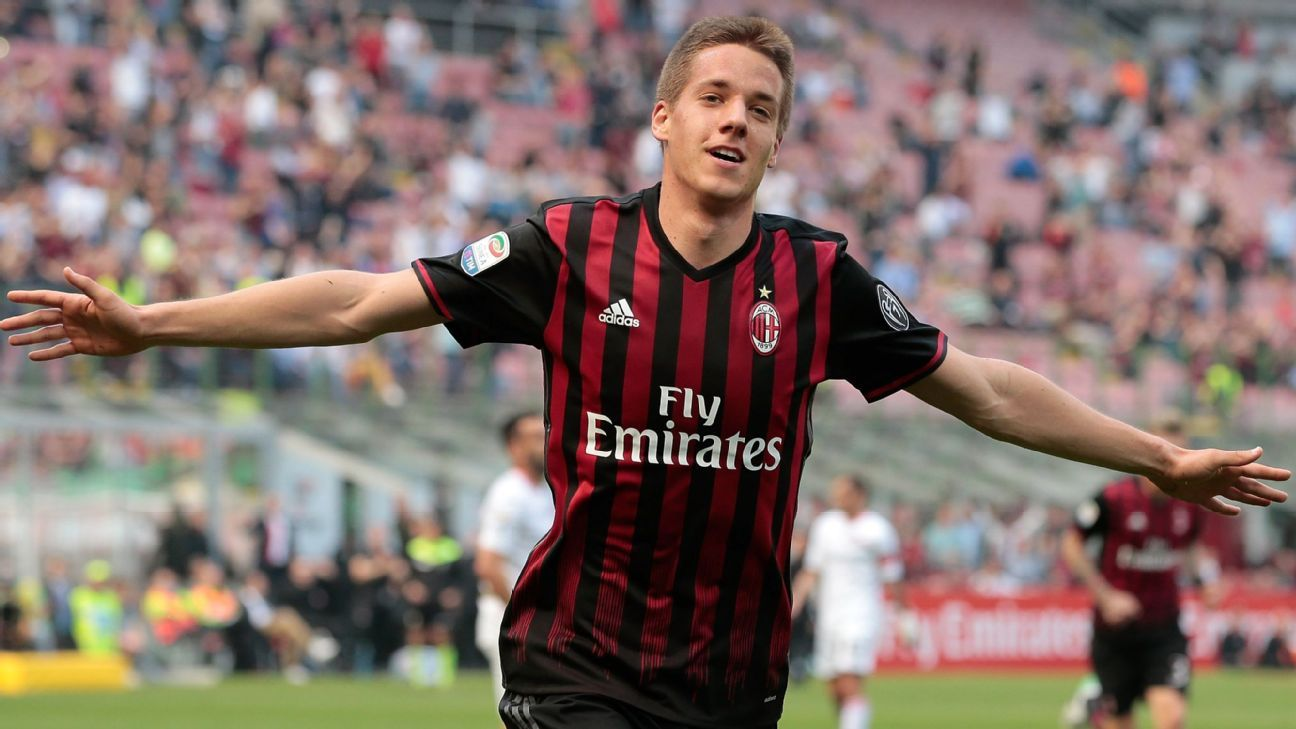 Mario Pasalic celebrates his goal for AC Milan during the Serie A match against Palermo at Stadio Giuseppe Meazza.