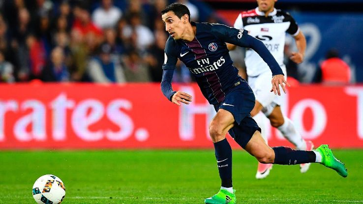 Angel Di Maria races onto the ball before scoring a goal against Guingamp.