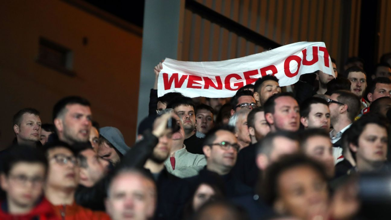 Arsenal fans have unfurled banners calling for Arsene Wenger's exit.