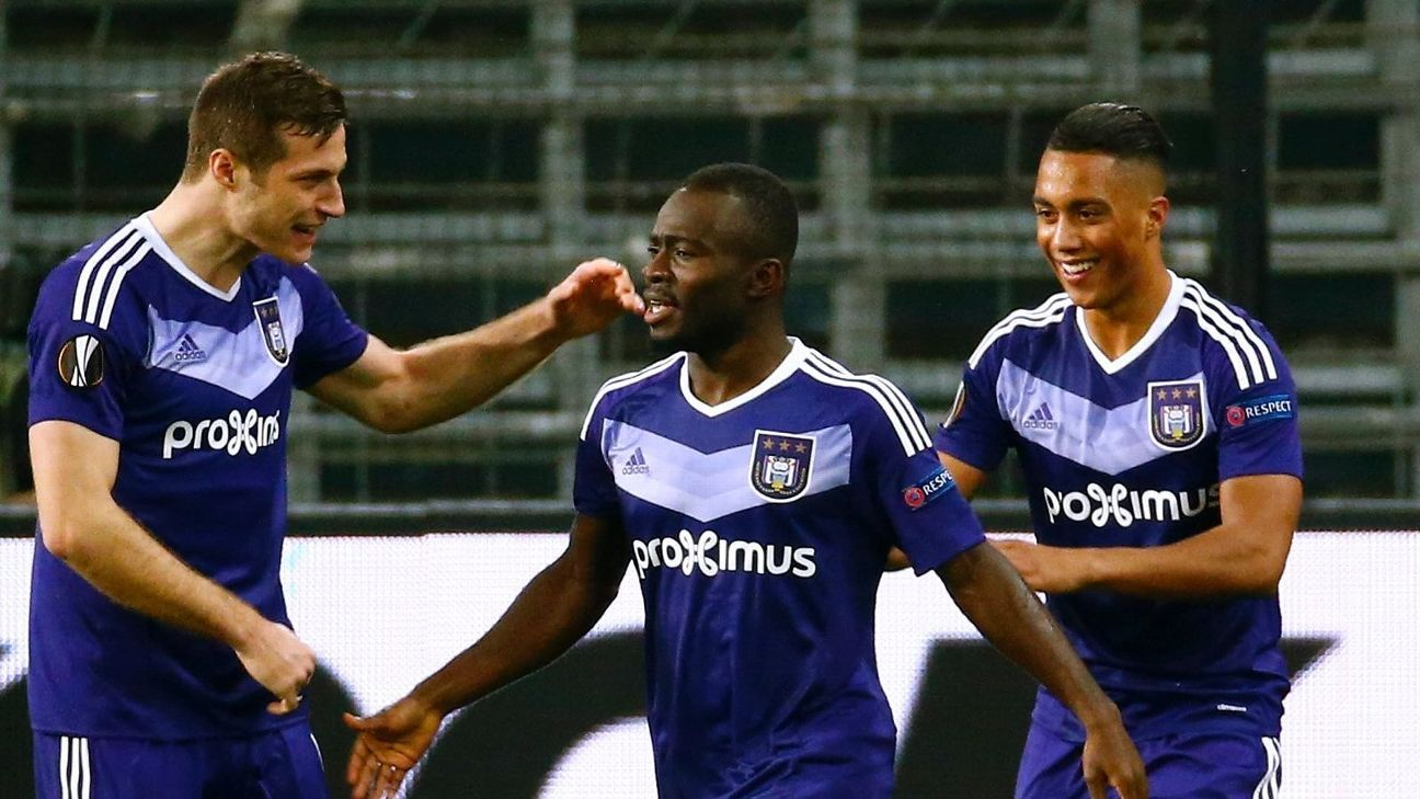 Frank Acheampong of Anderlecht is congratulated by teammates after scoring for Anderlecht against Apoel Nicosia in the Europa League.