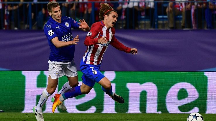Antoine Griezmann is fouled by Marc Albrighton in the penalty area in Atletico Madrid's UCL match vs. Leicester.