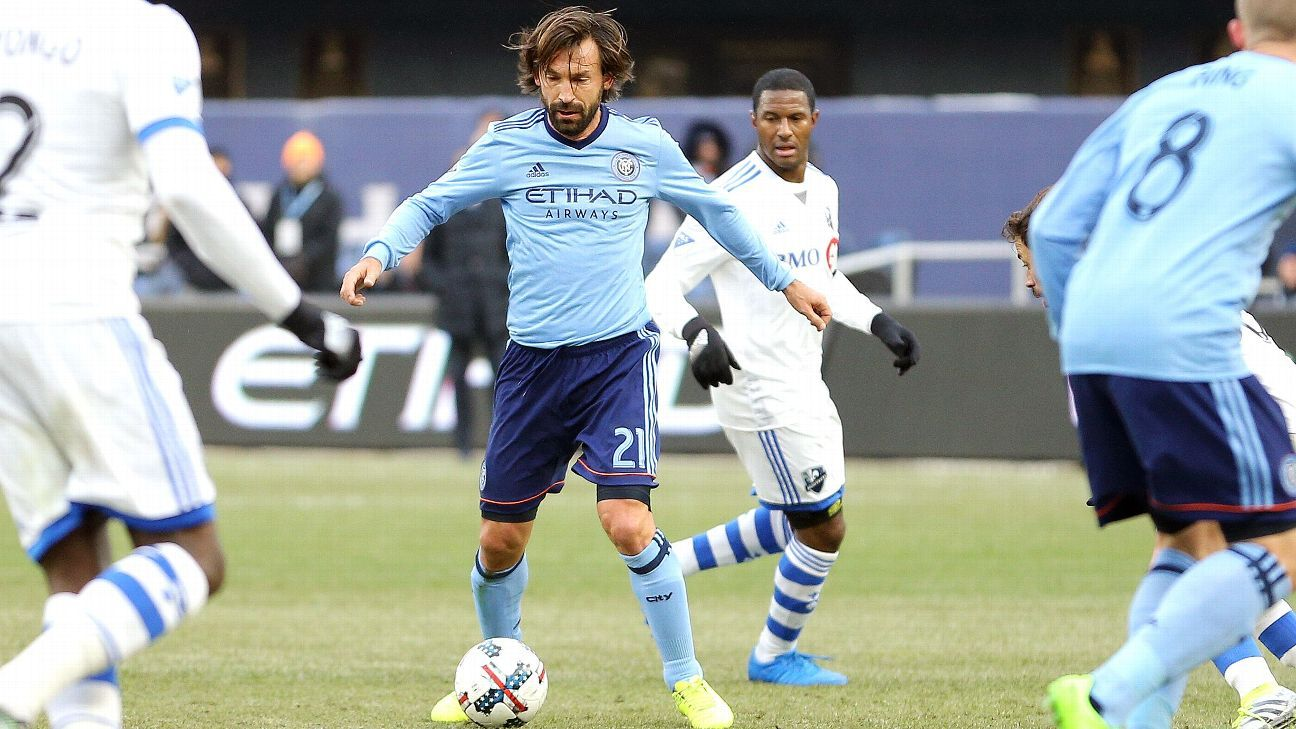 Andrea Pirlo dribbles between defenders in New York City FC's match against the Montreal Impact.