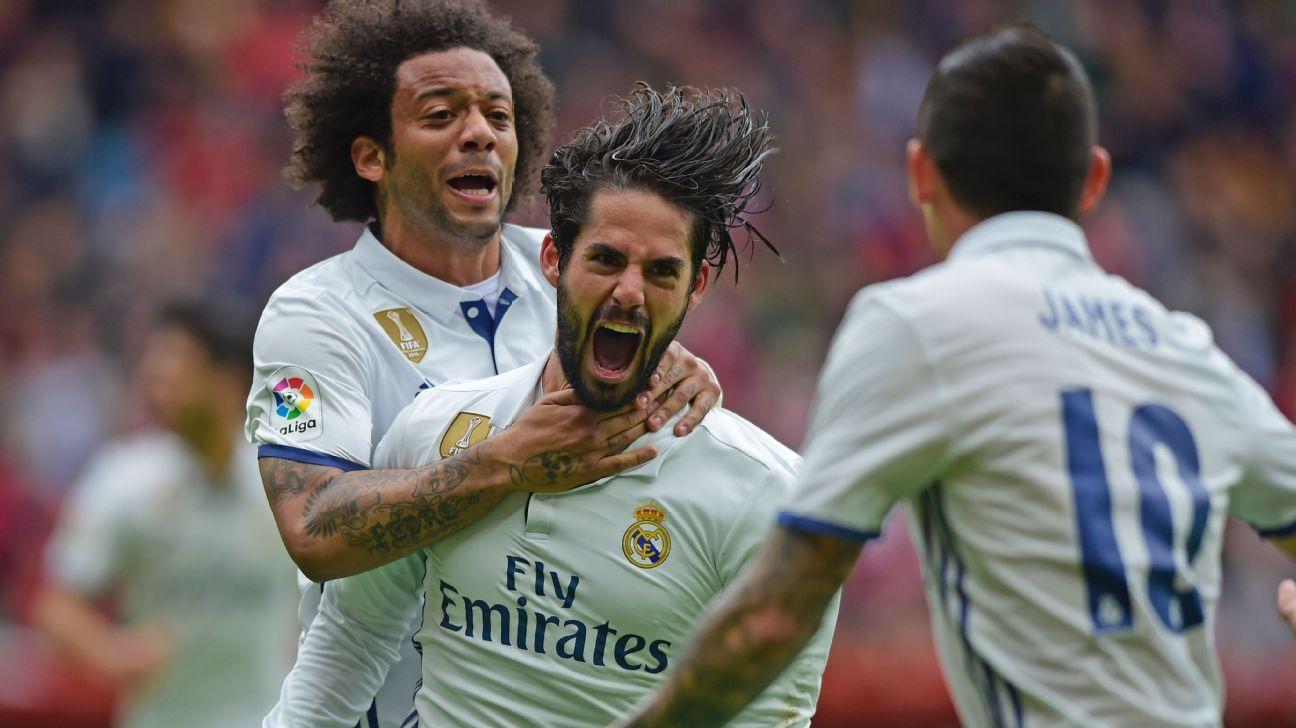 Real Madrid celebrate Isco's late winner.