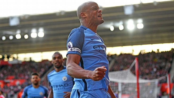 Vincent Kompany and Manchester City celebrate the opening goal.