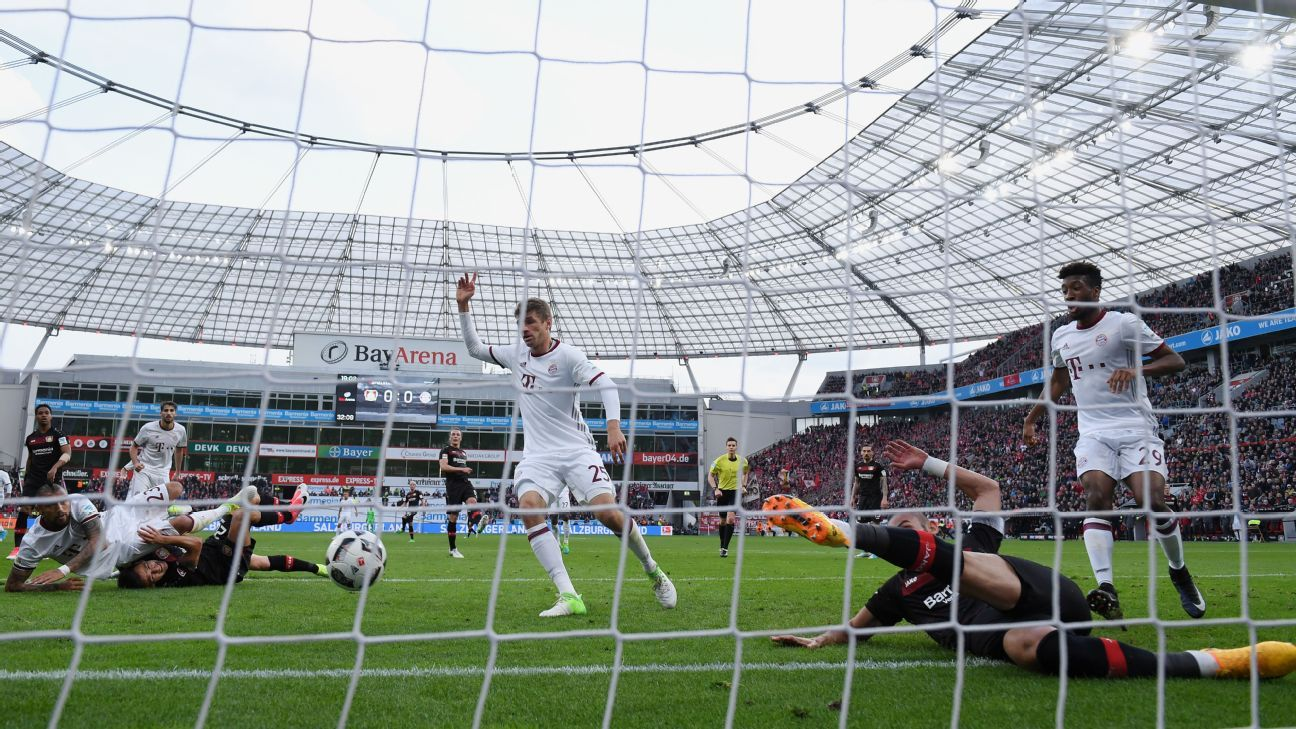 Leverkusen's Omer Toprak clears Arturo Vidal's effort off the line.