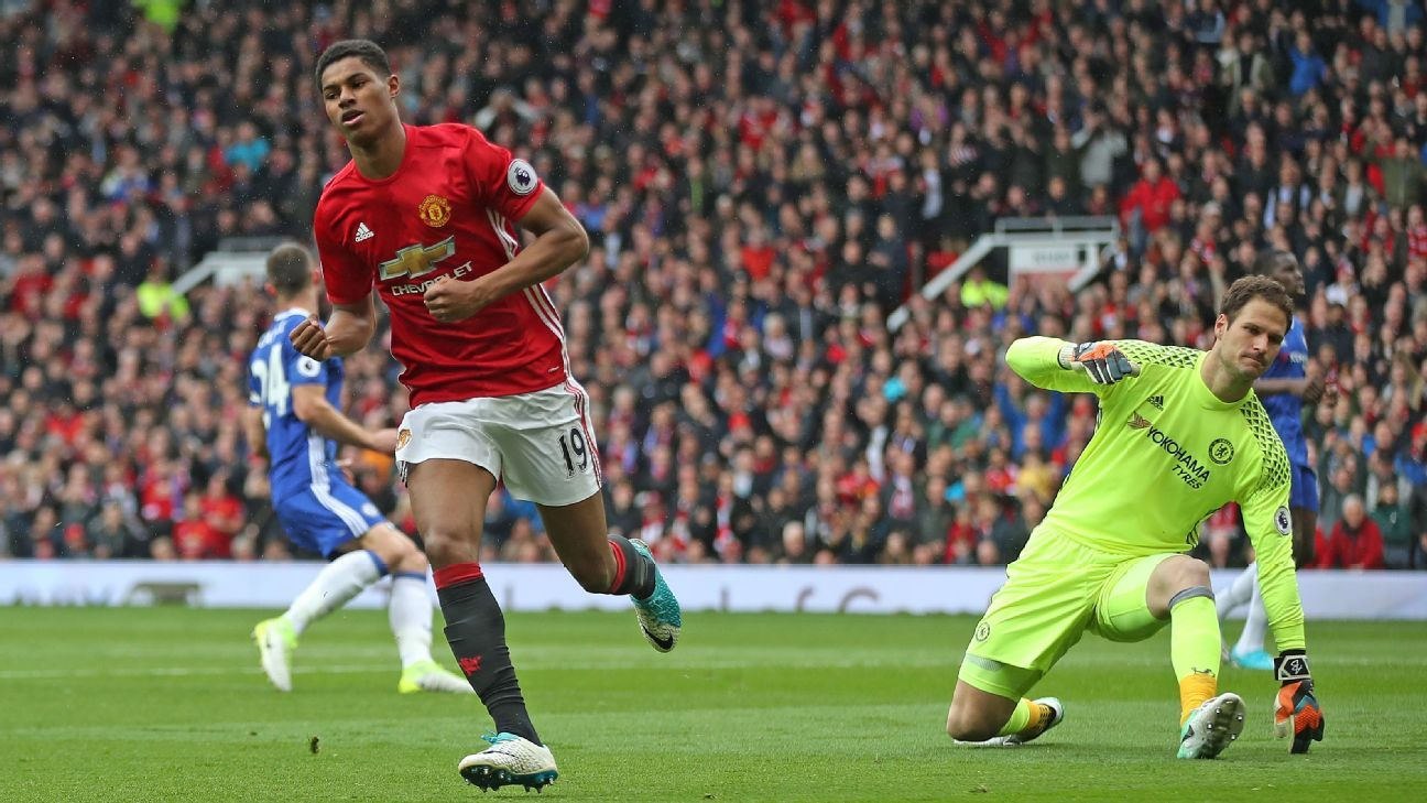 Marcus Rashford wheels away after opening the scoring for United.