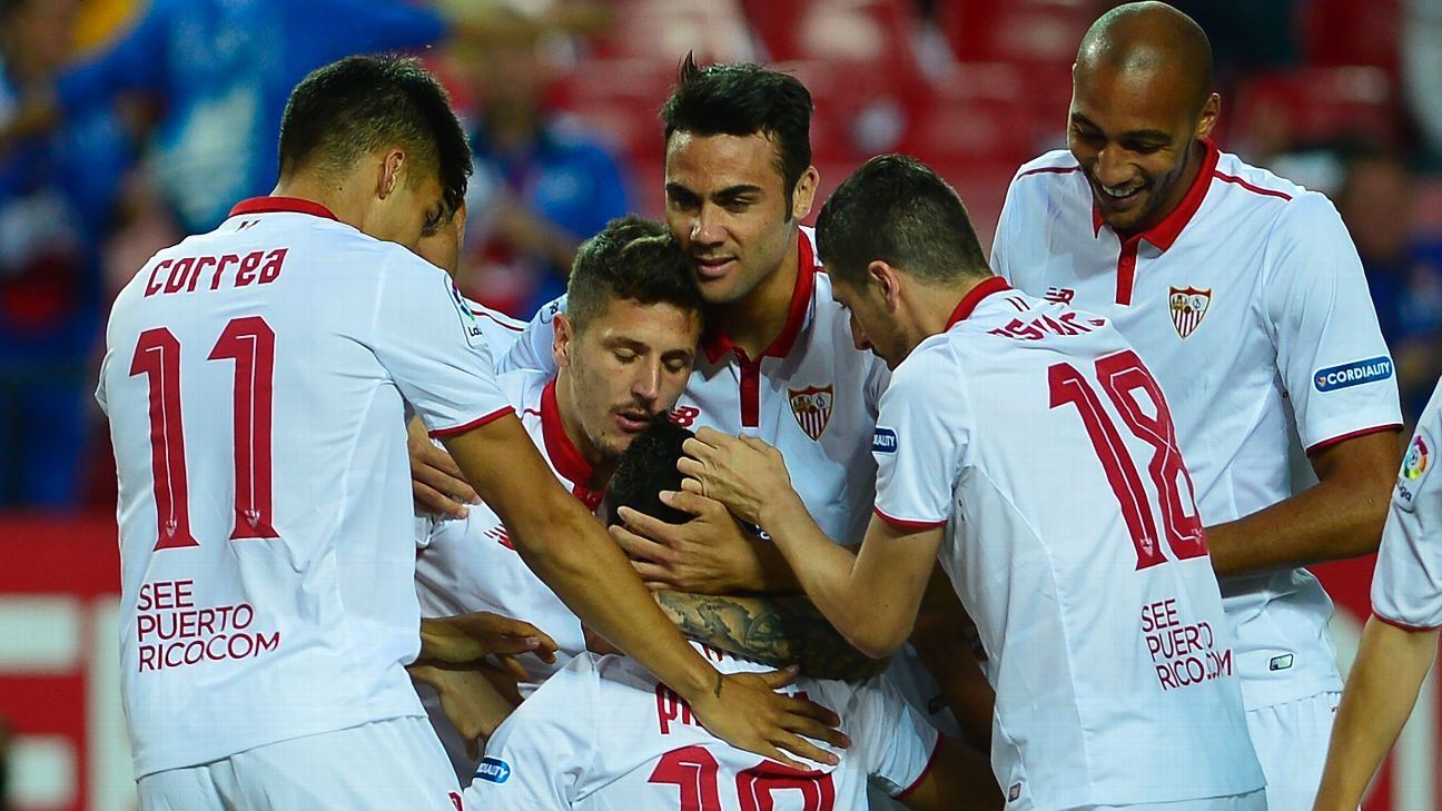 Sevilla players celebrate after midfielder Ganso scored a goal in a La Liga win versus Granada.