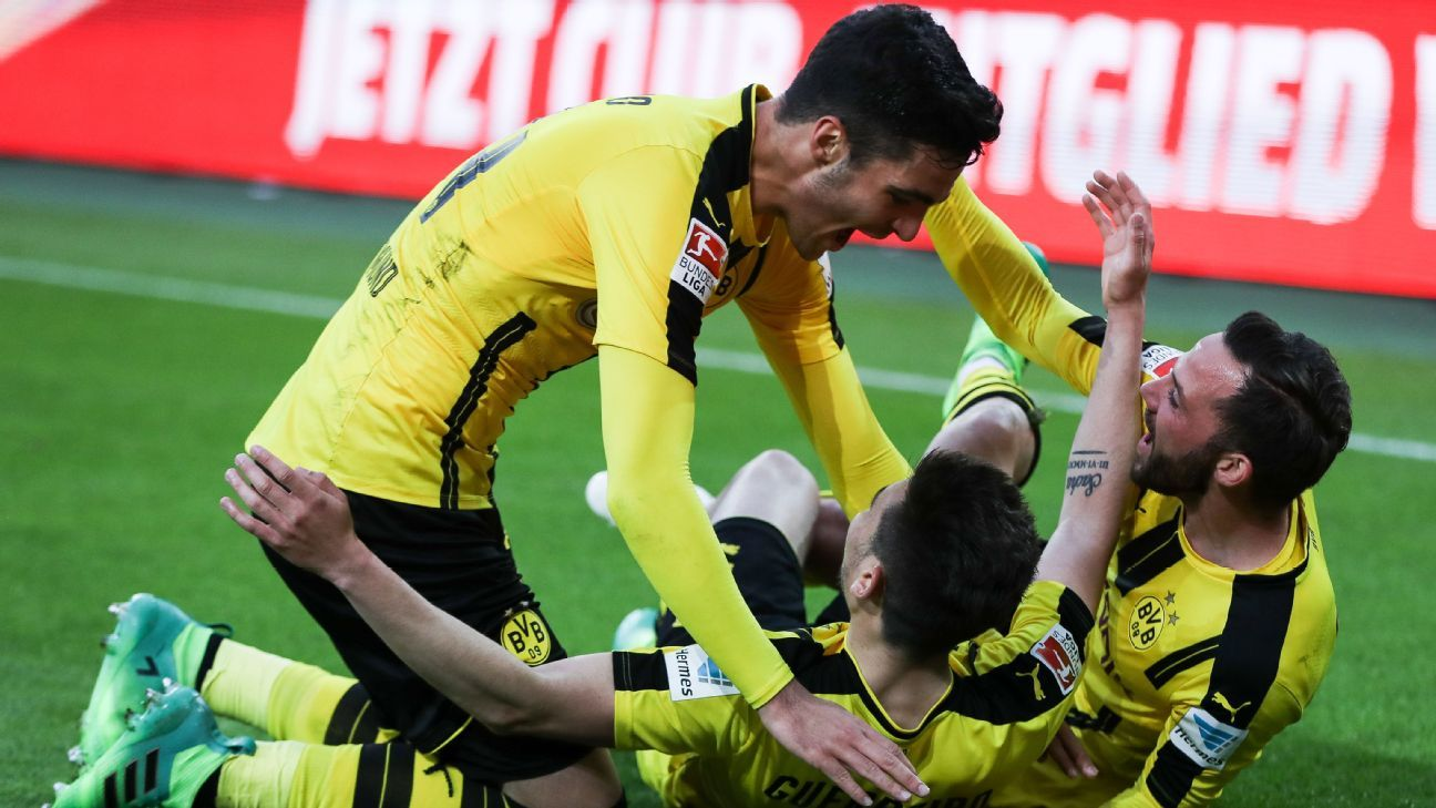 Raphael Guerreiro celebrates after heading home a late winner for Dortmund.