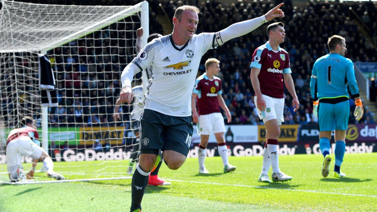 Wayne Rooney celebrates after doubling United's lead at Turf Moor.