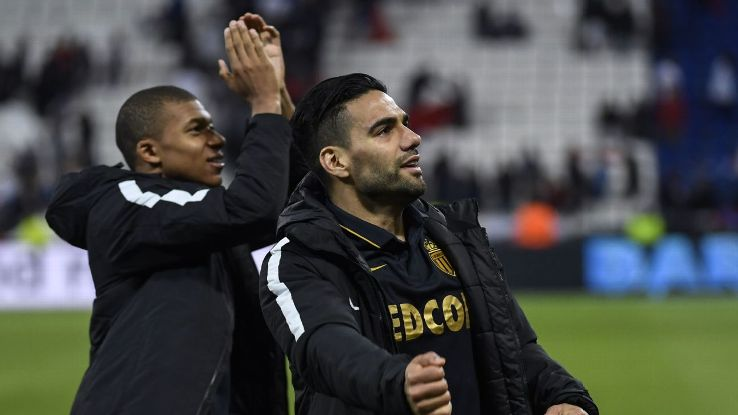 Kylian Mbappe & Radamel Falcao celebrate with Monaco supporters after defeating Lyon 2-1 on Sunday.