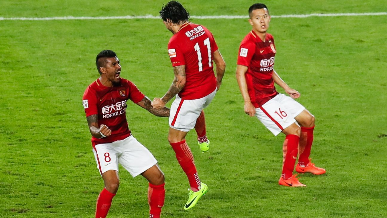 Ricardo Goulart of Guangzhou Evergrande celebrates with Paulinho