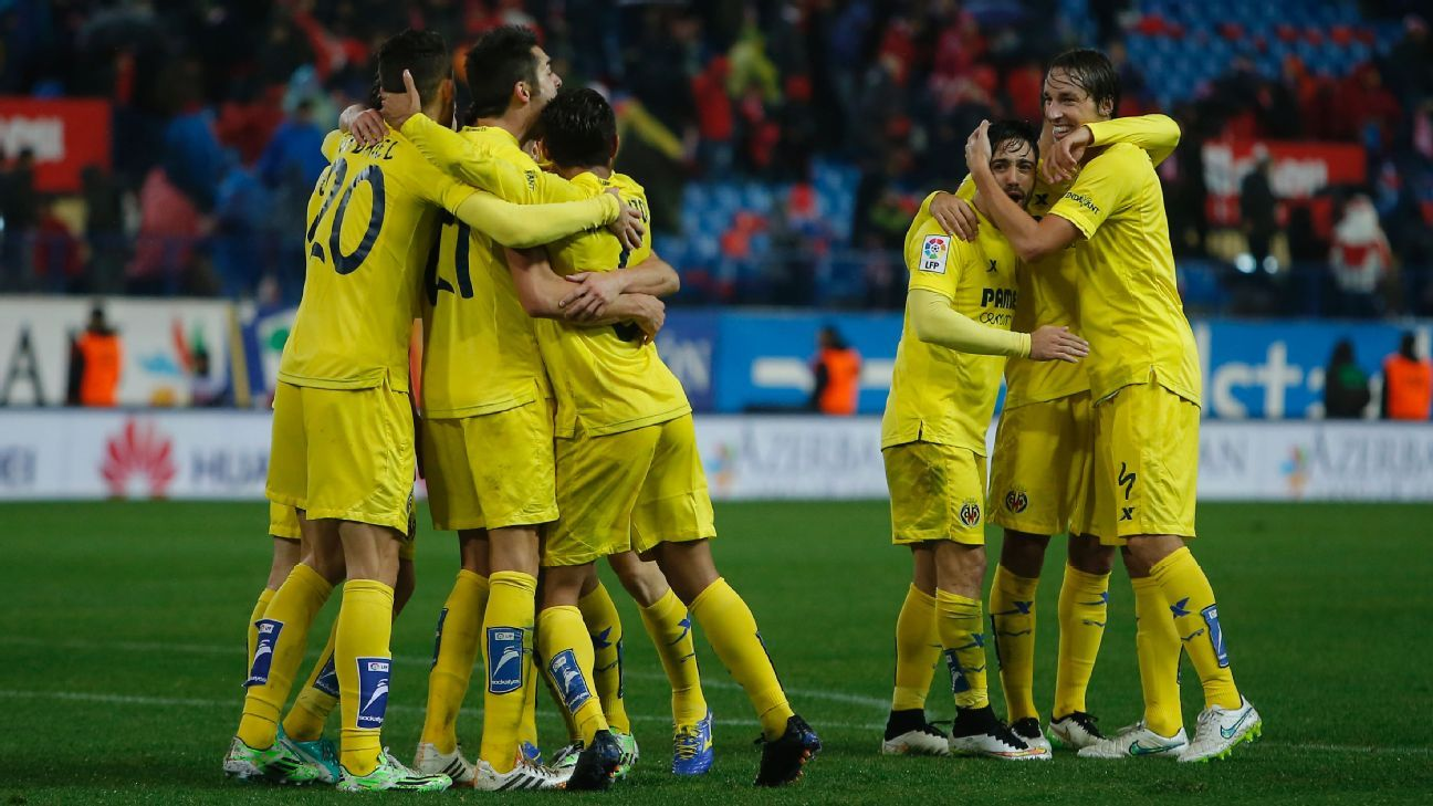 Villarreal's players celebrate their victory against Atletico Madrid on Tuesday night.