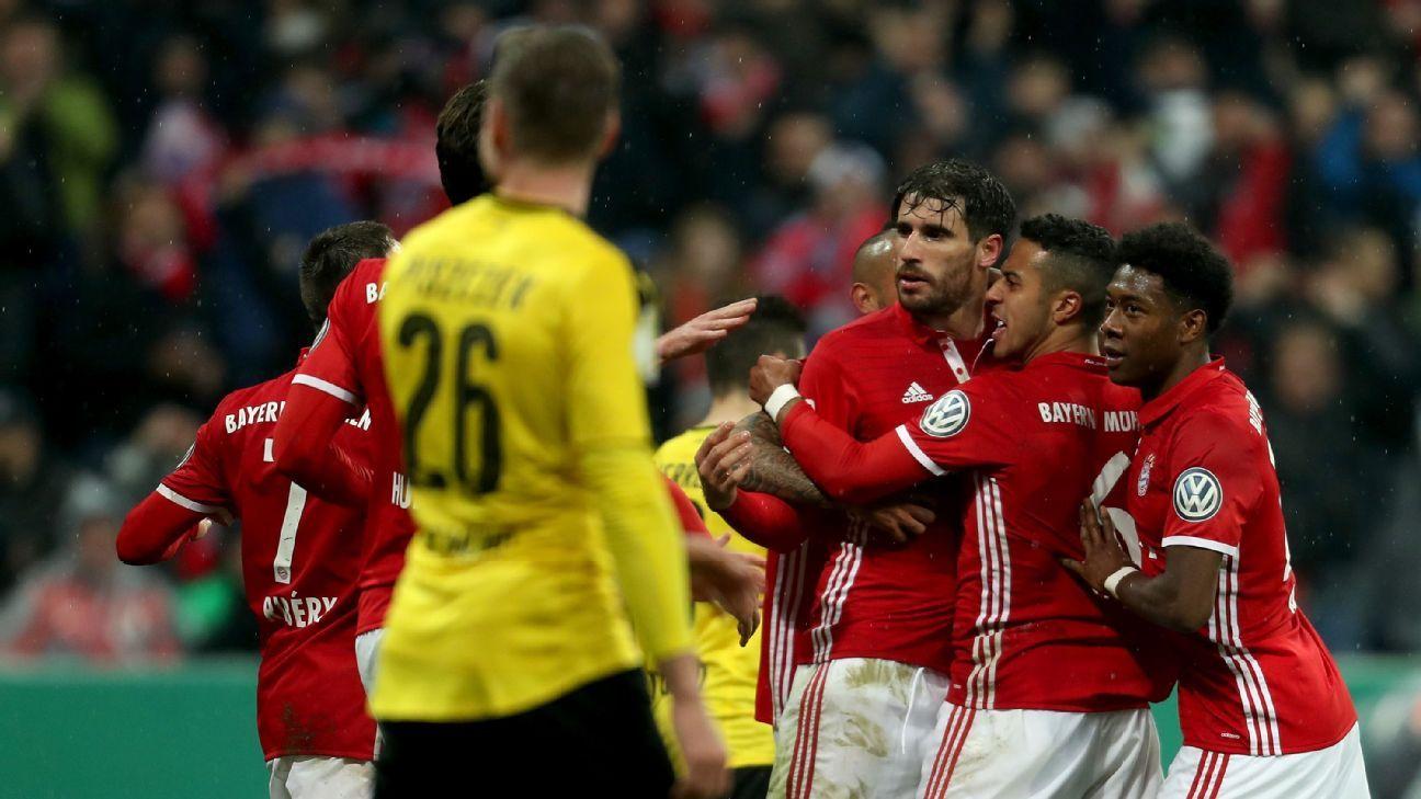 Bayern Munich players celebrate after Javi Martinez scored a goal in their DFB Pokal match against Borussia Dortmund.