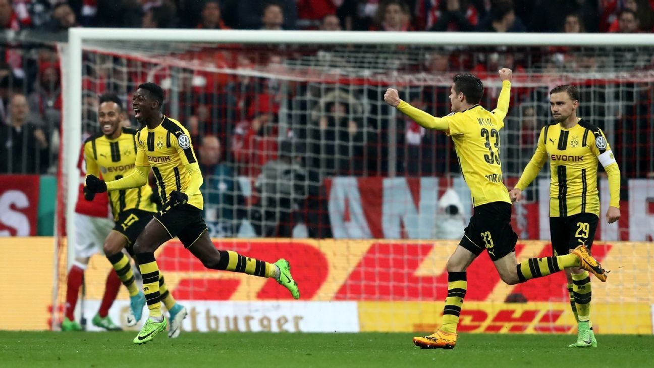 Ousmane Dembele celebrates after putting Borussia Dortmund ahead against Bayern Munich in the DFB Pokal Cup.